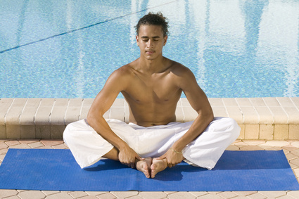 young male practicing yoga