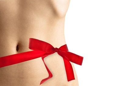 Womans perfect waistline wrapped with a beautiful red ribbon lik