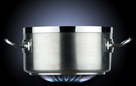 inox saucepan with gas flame