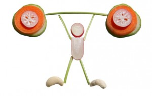 Eat healthy! Sliced vegetables in a form of weight-lifter