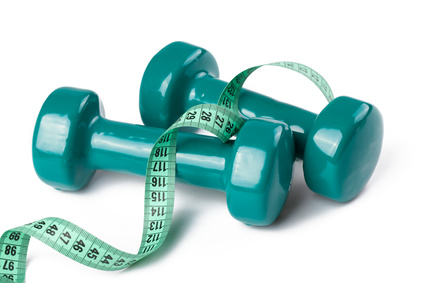 green dumbell with measuring tape